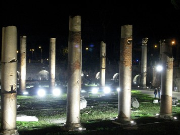 Trajan's Forum is illuminated at night.