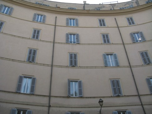 Curved wall of facade fronting existing piazza