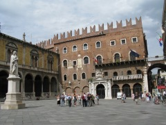 Piazza dei Signori, where a statue of the poet Dante keeps a watchful eye